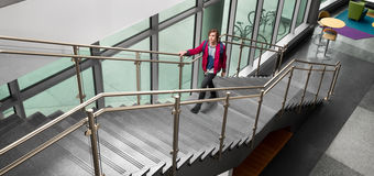 Colored glass that reduces the transmission of undesired light and heat - man walking up stairs