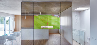 Guardian Dielectric Mirror wall showing a television screen