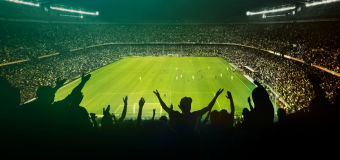 Sports stadium illuminated by lighting with Guardian Glass lenses
