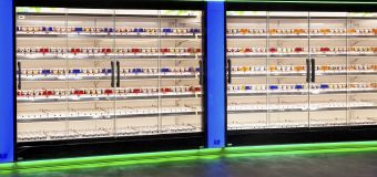 Refrigerators in the dairy section of a supermarket that use Guardian ThermaGuard glass