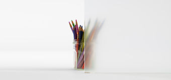 Colorful pencils in a glass showing behind Guardian acid-etched glass to demonstrate privacy