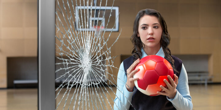 broken Guardian laminated glass and girl holding soccer ball