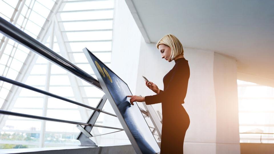 Women using Guardian a touch-sensitive glass screen