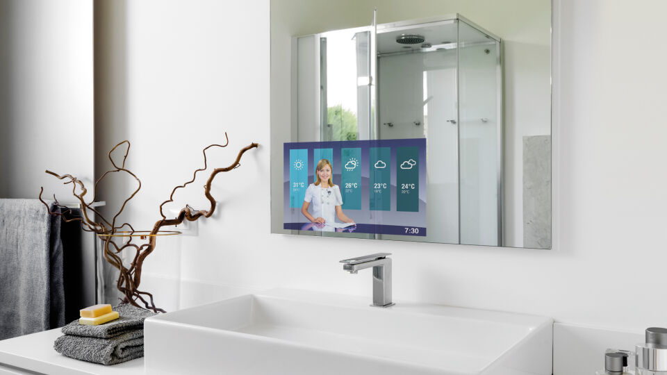 Guardian Dielectric Mirror displaying the weather forecast above a modern bathroom sink