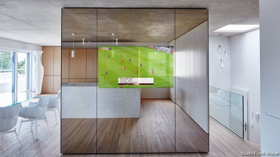 Guardian Dielectric Mirror displaying a soccer game in a contemporary kitchen