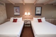 Partial View Double Queen Room with Kitchenette