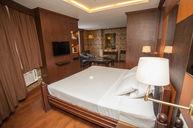 Suite Room with Black-Tiled Bathroom