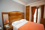 Adjoining Four Person Rooms with Two Single Beds + One Double Bed
