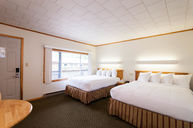 Center Room with 1 Queen and 1 Double Bed