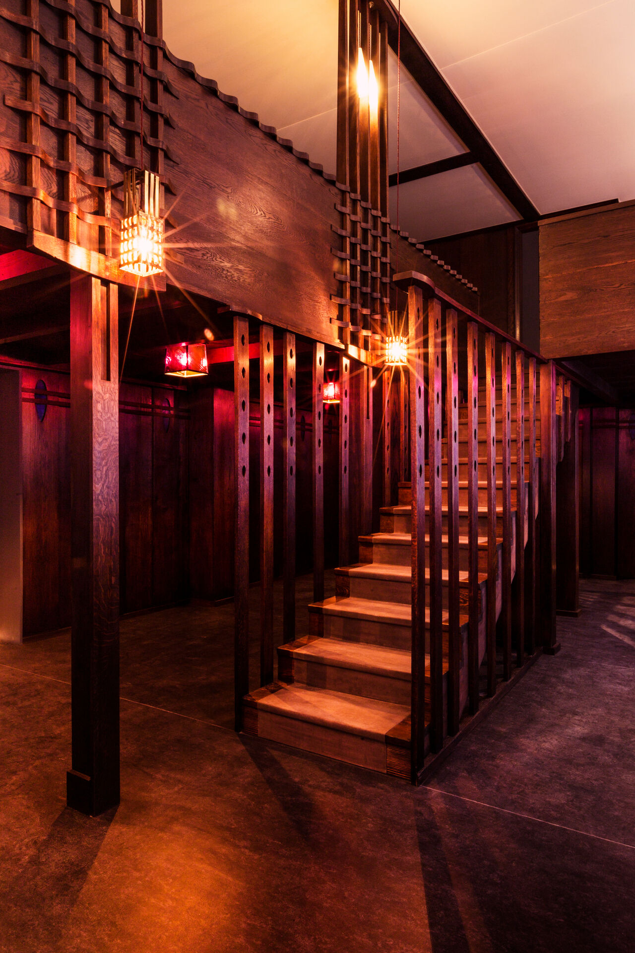 Mackintosh's Oak Room, all dark wood and purple glass. A staircase rises to the upper level.
