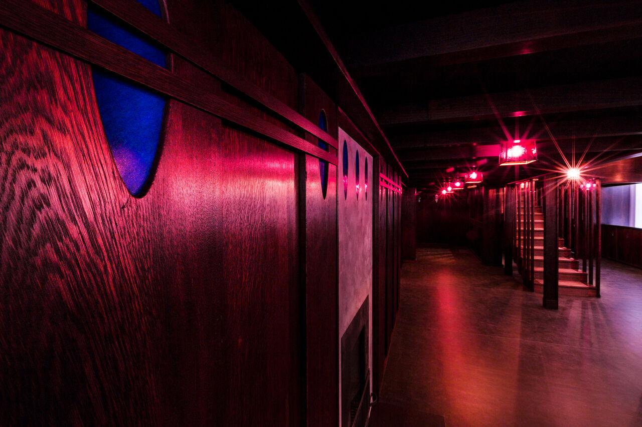 Mackintosh's Oak Room, all dark wood and purple glass.