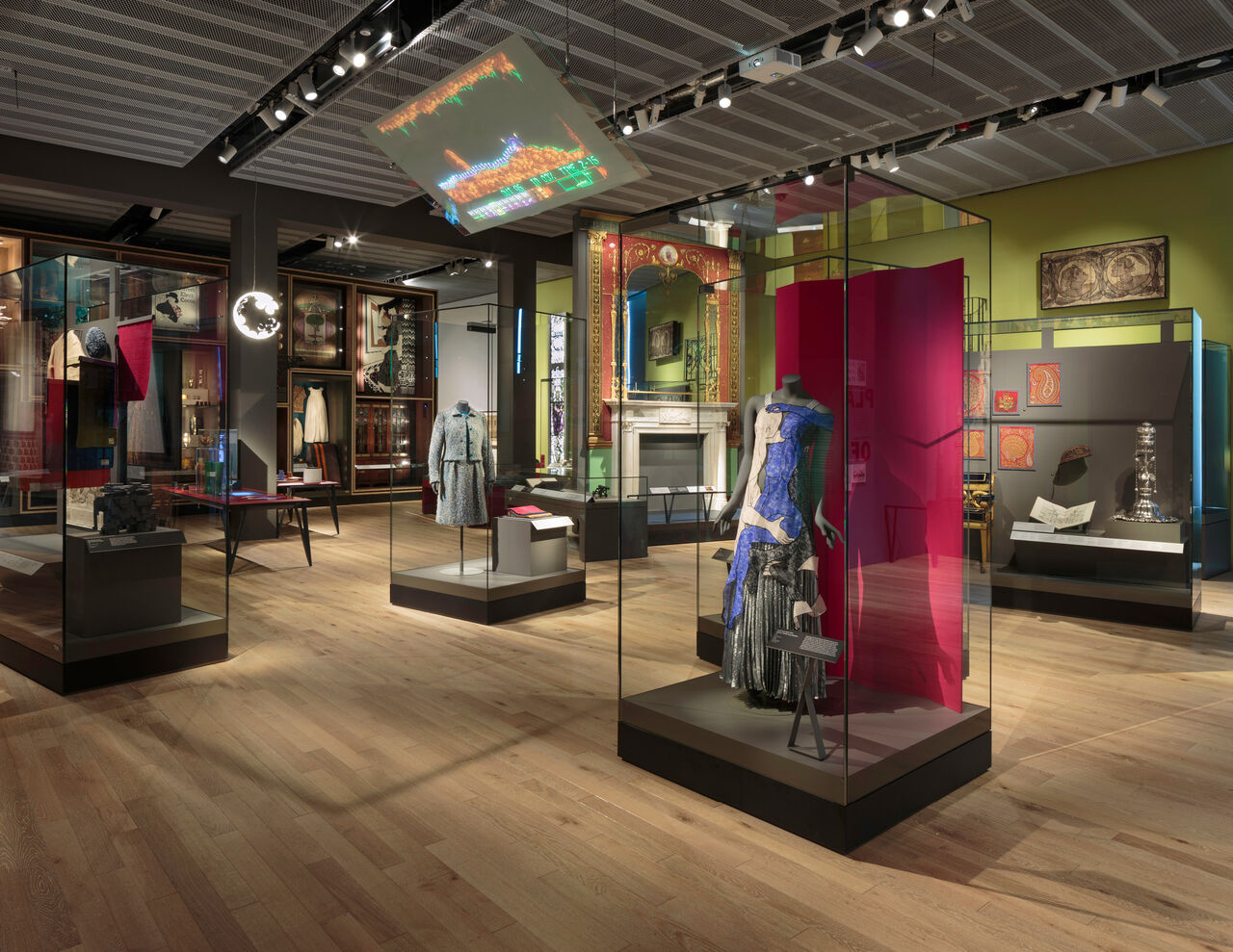 Photo of the Scottish Design Galleries at V&A Dundee. Many display cases show off objects exploring Scotland's design history, from fashion to textiles to ironwork to comics and furniture.