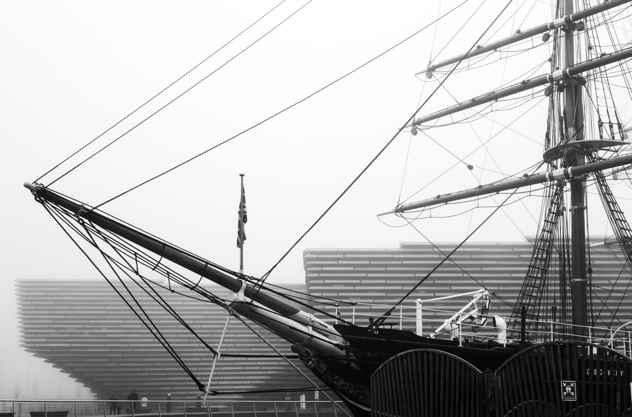 The RRS Discovery in front of V&A Dundee. It's a bit misty sand atmospheric. Black and white.