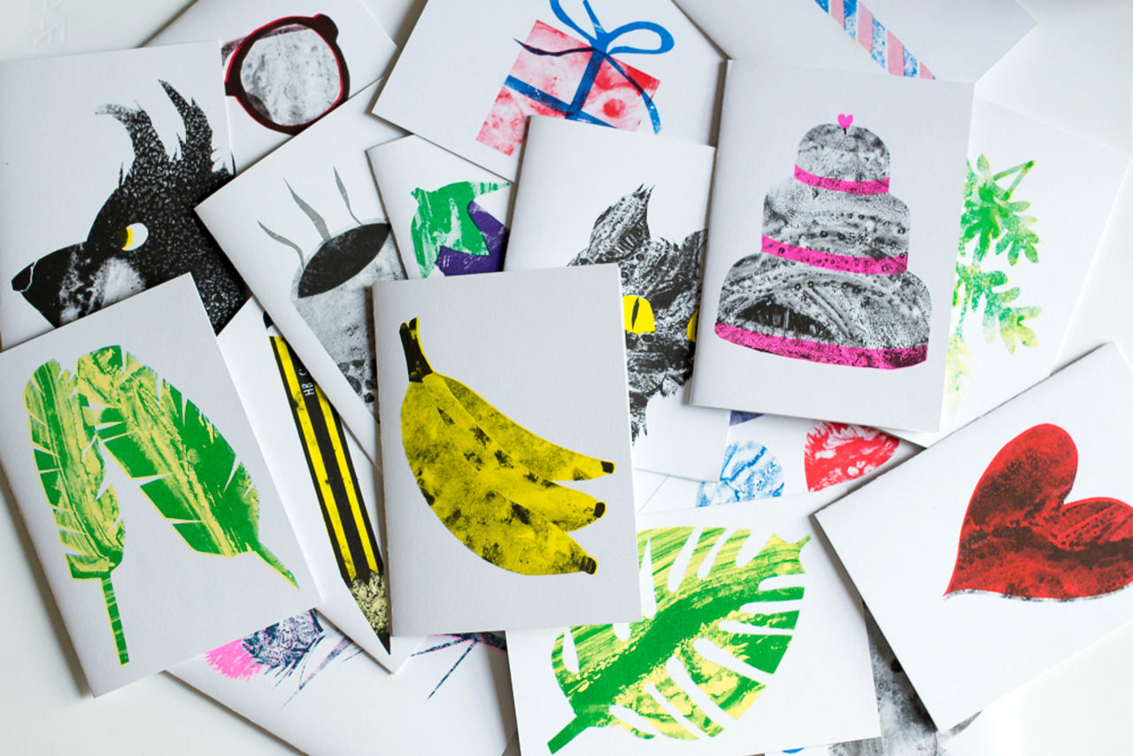 A pile of beautifully illustrated colourful greetings cards featuring animals.
