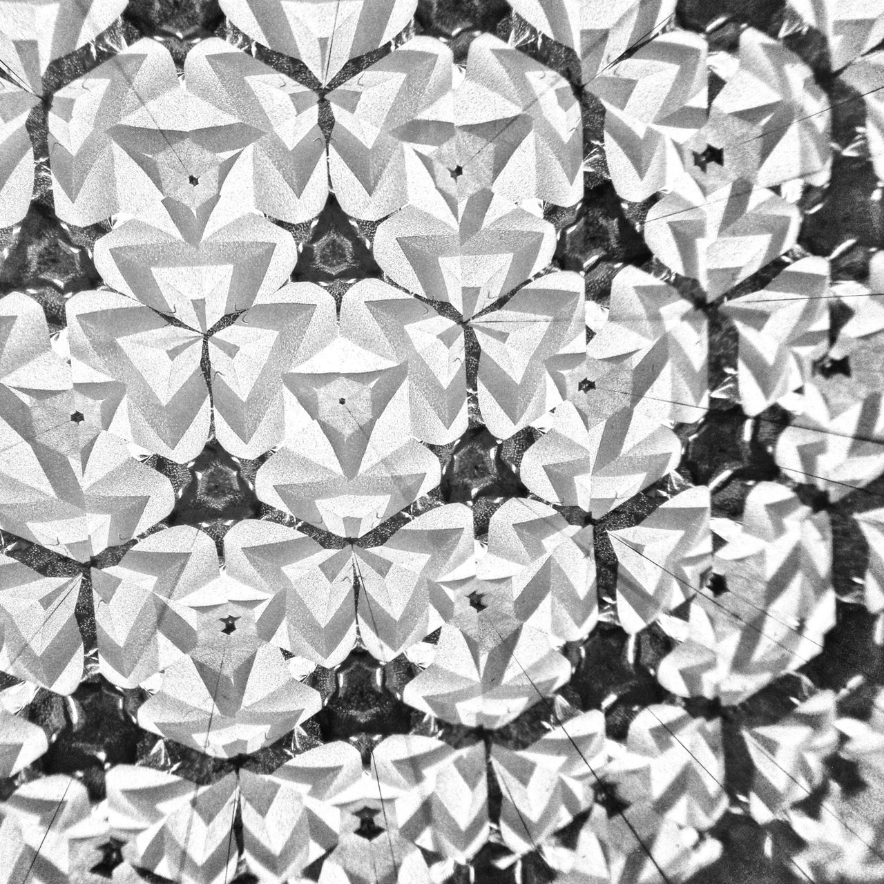 Black and white photo taken through a kaleidoscope showing abstract shapes and lines.