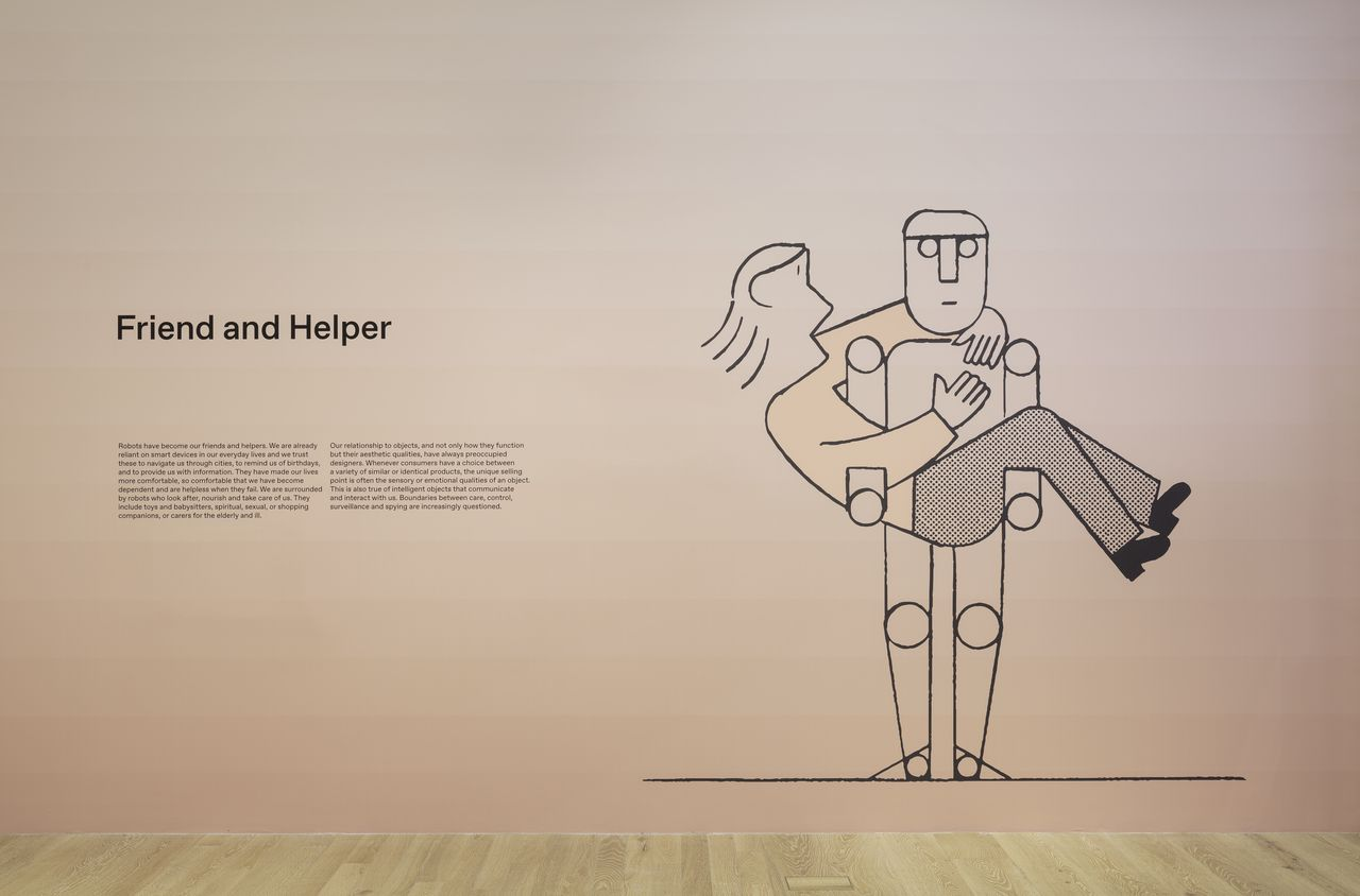 Wall of the gallery in Hello Robot with line drawings of robots in different situations.