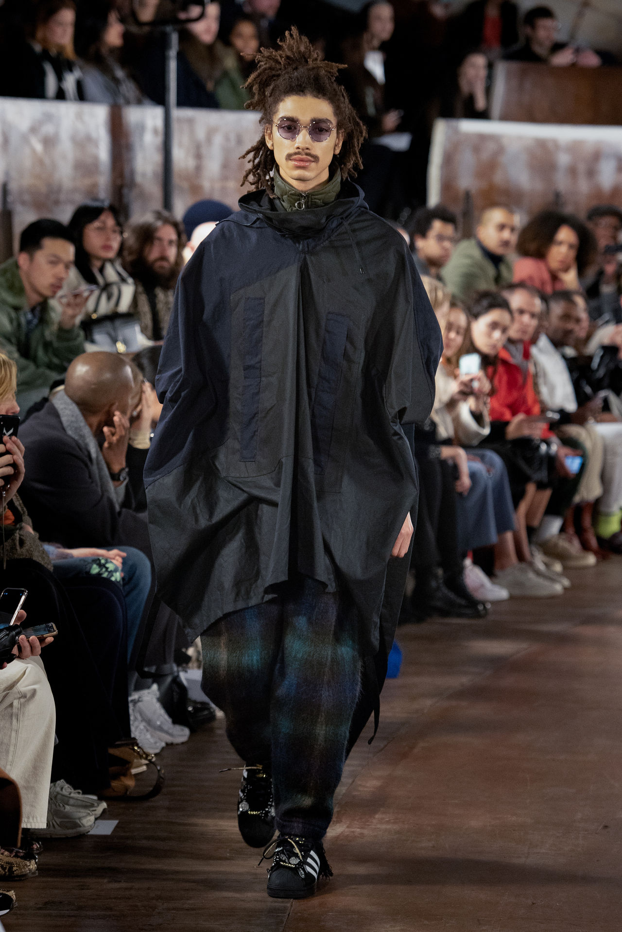 A model walking down the runway wearing Nicholas Daley's Autumn Winter 2020 collection.