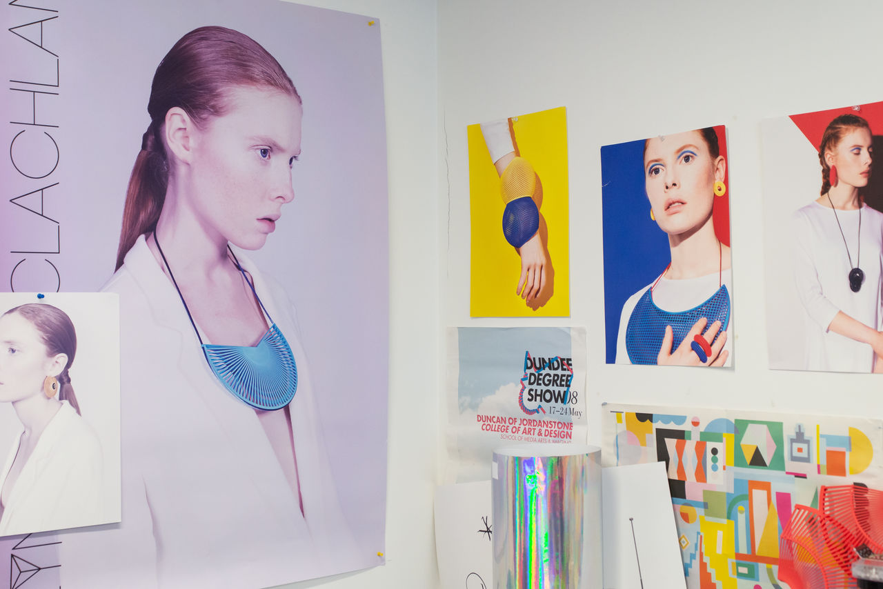 A corner of the studio where the walls are adorned with vibrant posters of models wearing her amazing jewellery.