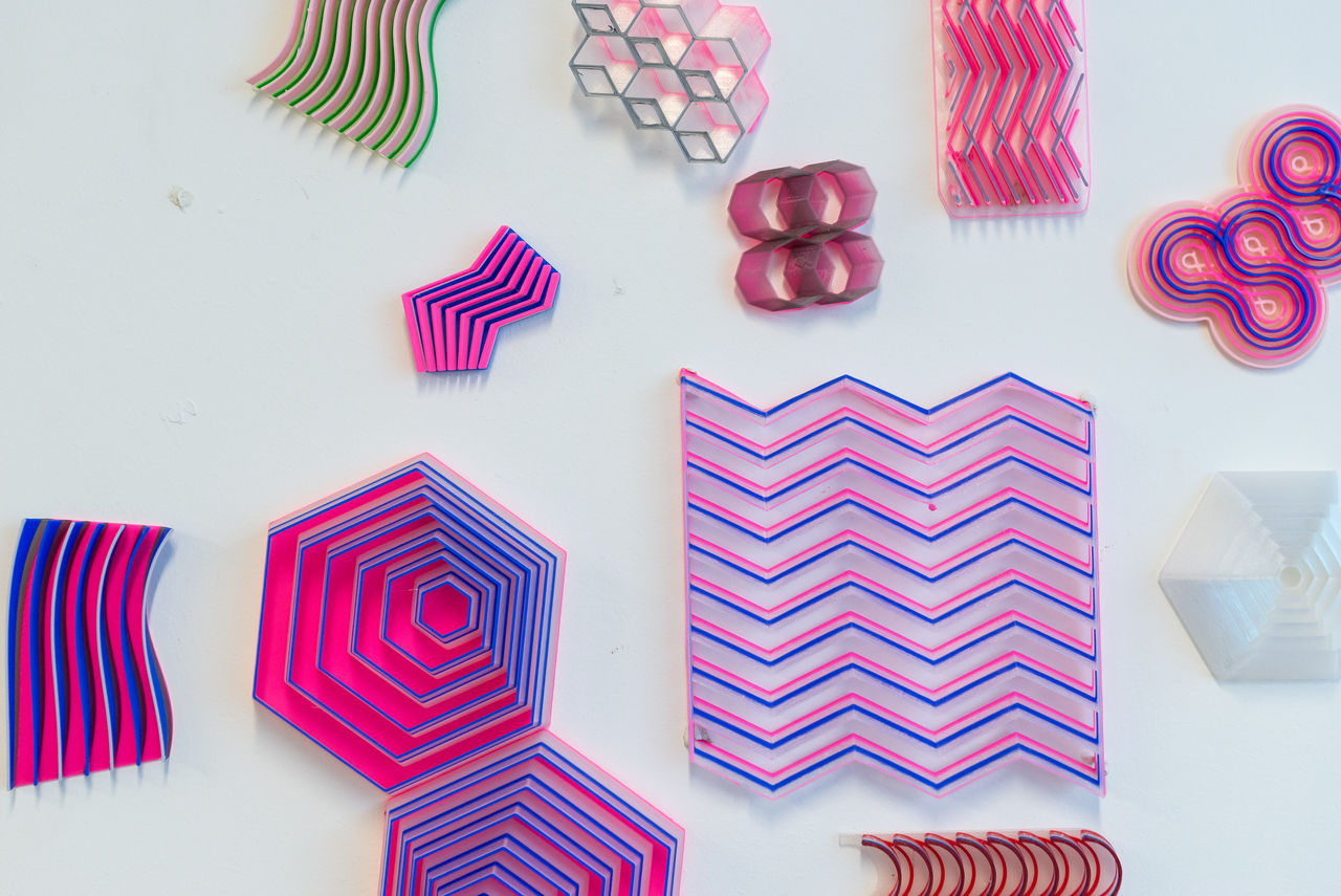A selection of colourful plastic structures of different shapes and forms.