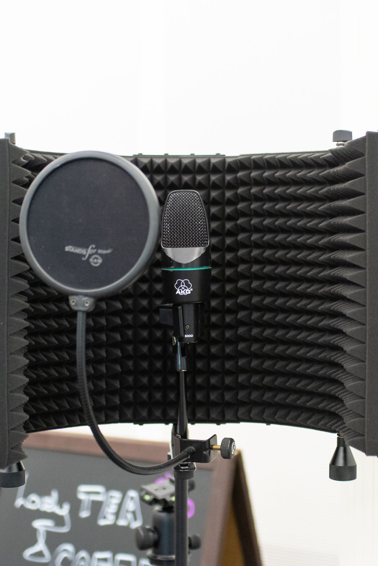 A microphone setup with a small sound dampener around it.