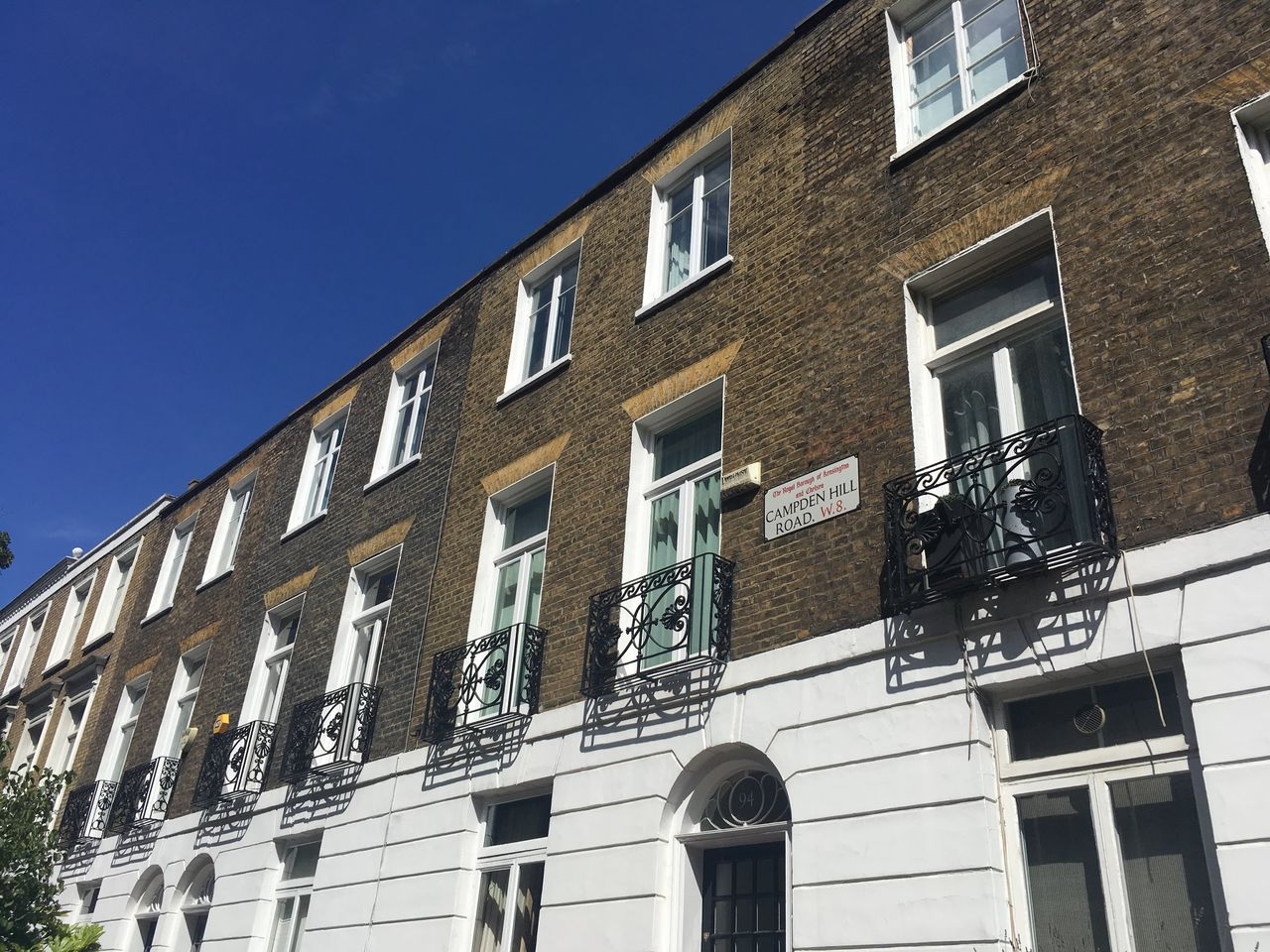 A terrace of houses in London with the balcony adoring them.