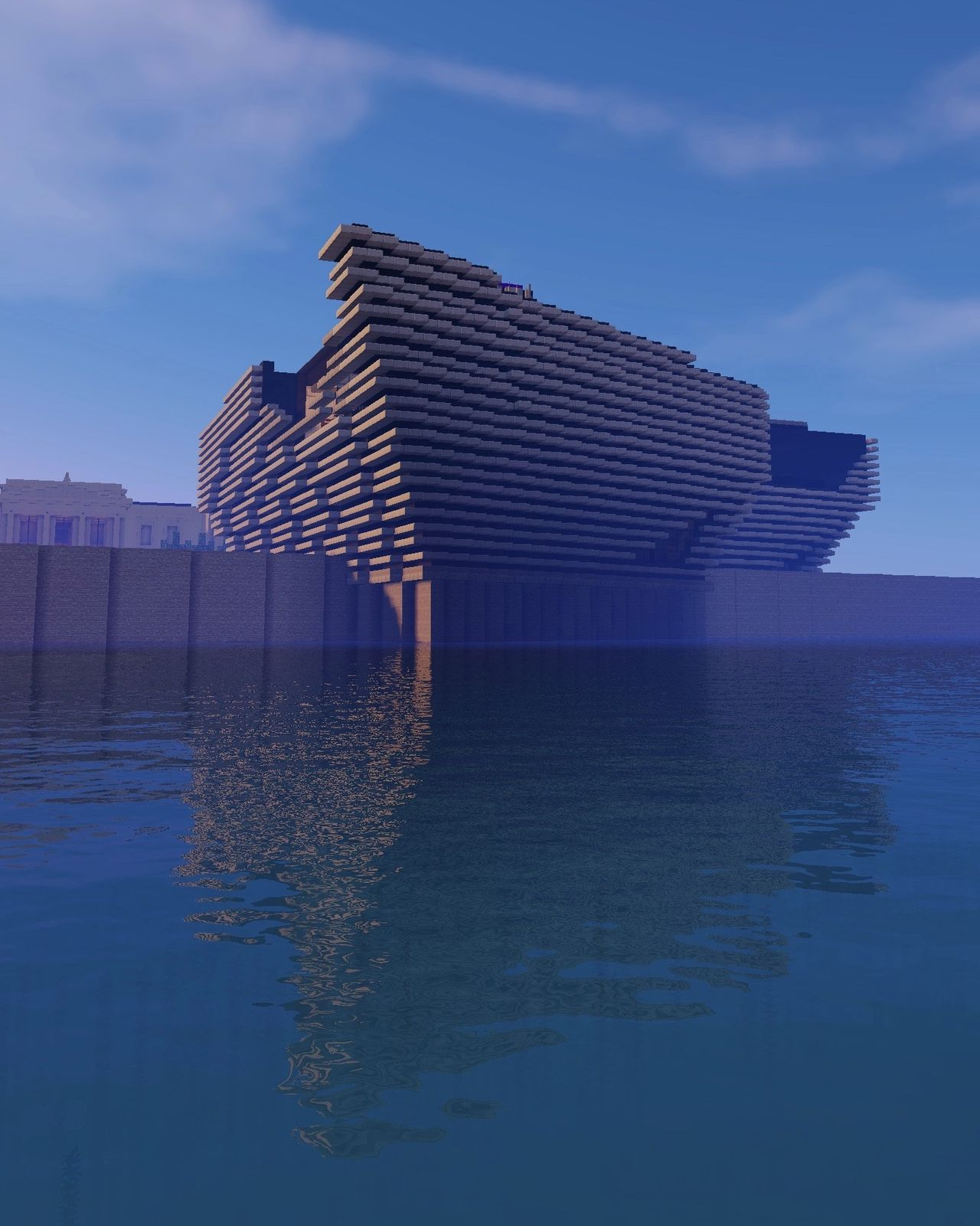 V&A Dundee's building recreated in Minecraft with a bright blue sky around it.