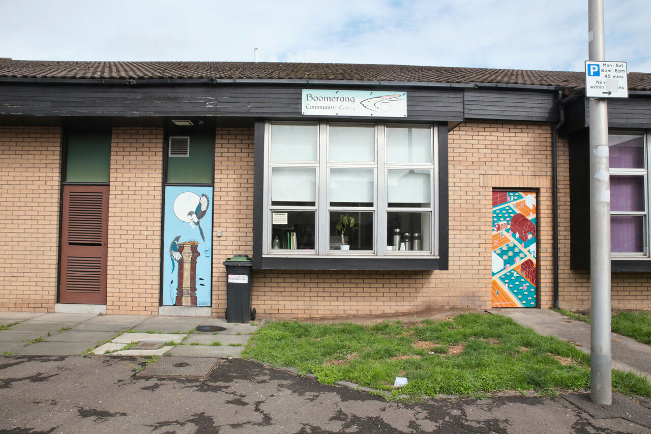 The front of the Boomerang Centre in Dundee with a couple of its doors painted in colourful murals.