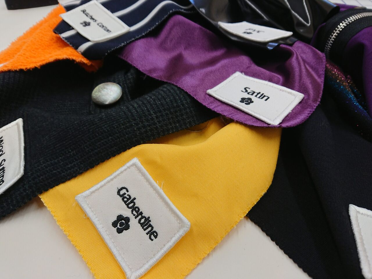 A selection of different fabric types (like PCV or towelling) in different colours.