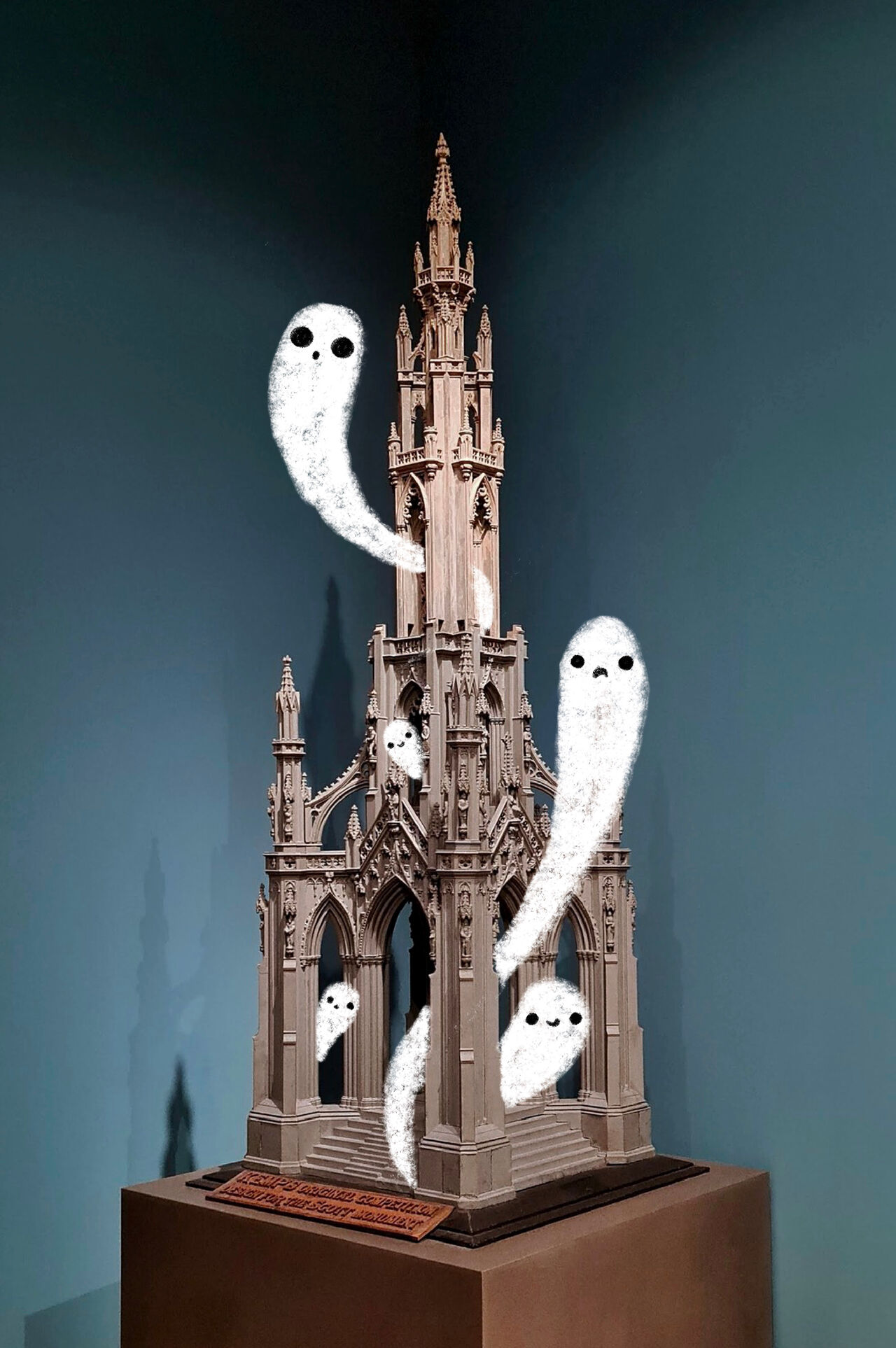 Photo of the model of the Wallace monument in our galleries with illustrated white ghosts drifting around it.
