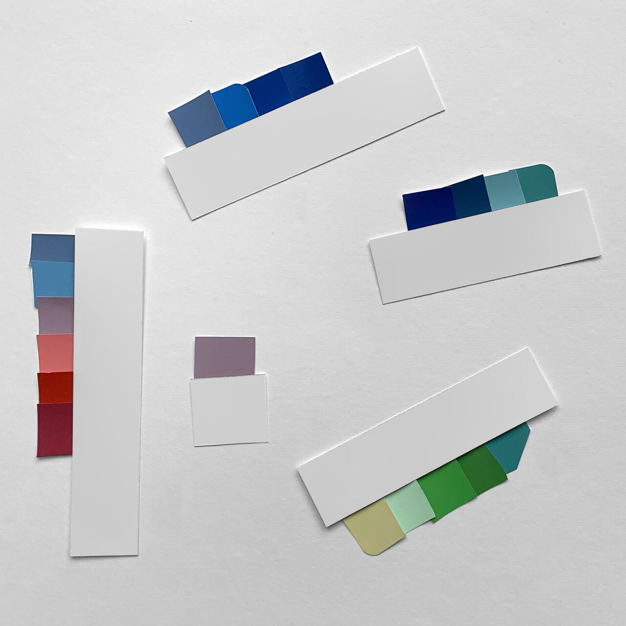 Tabs of different colours against a white background. Mainly blues and greens.