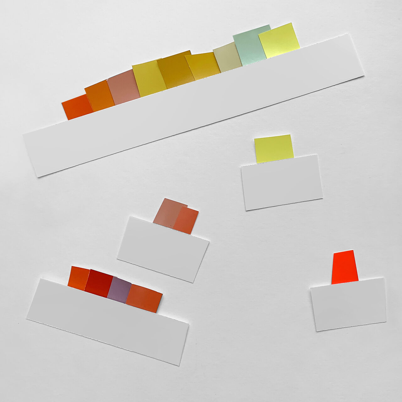 Tabs of different colours against a white background. Mainly orange, red and yellow.