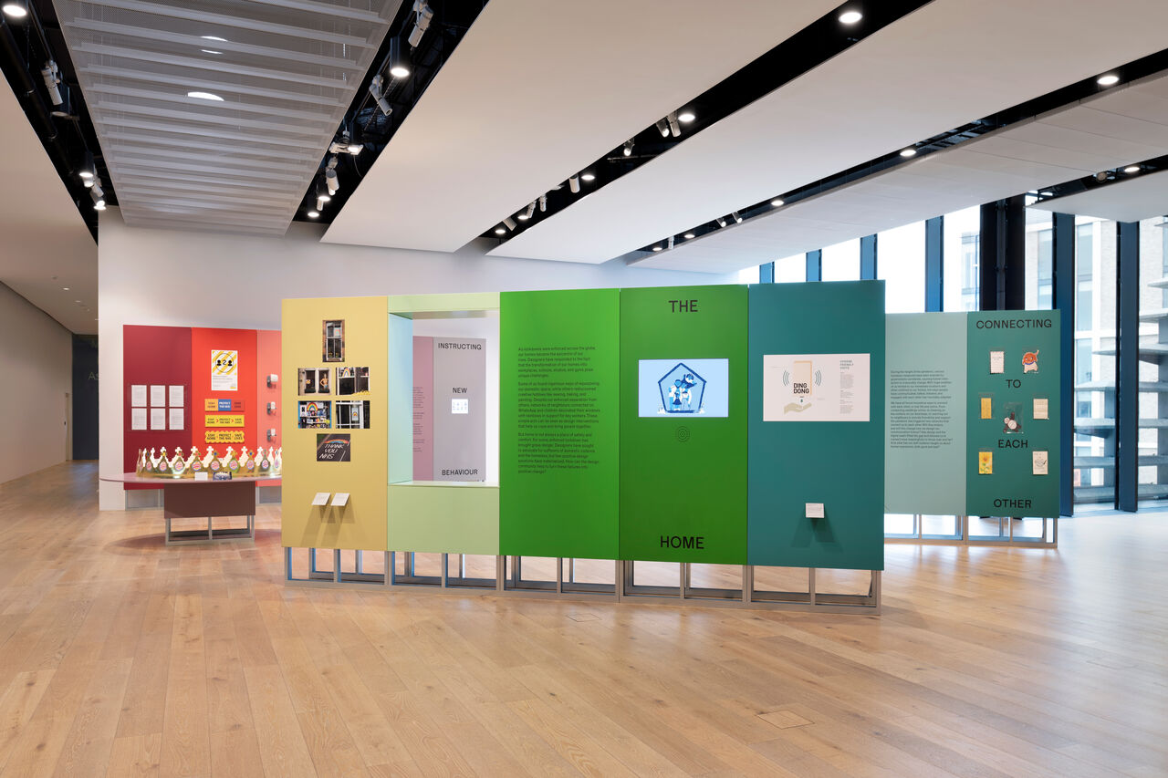 Now Accepting Contactless exhibition in the upper hall of V&A Dundee. Multicoloured panels and plinths form a deconstructed rainbow.
