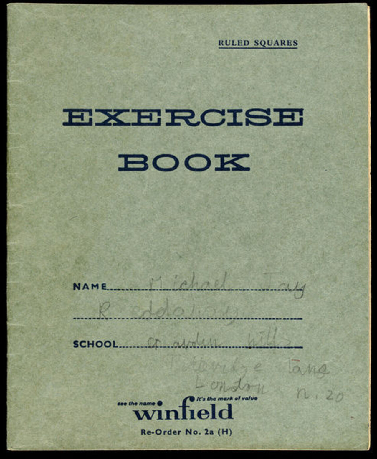 Photo of a green exercise jotter.