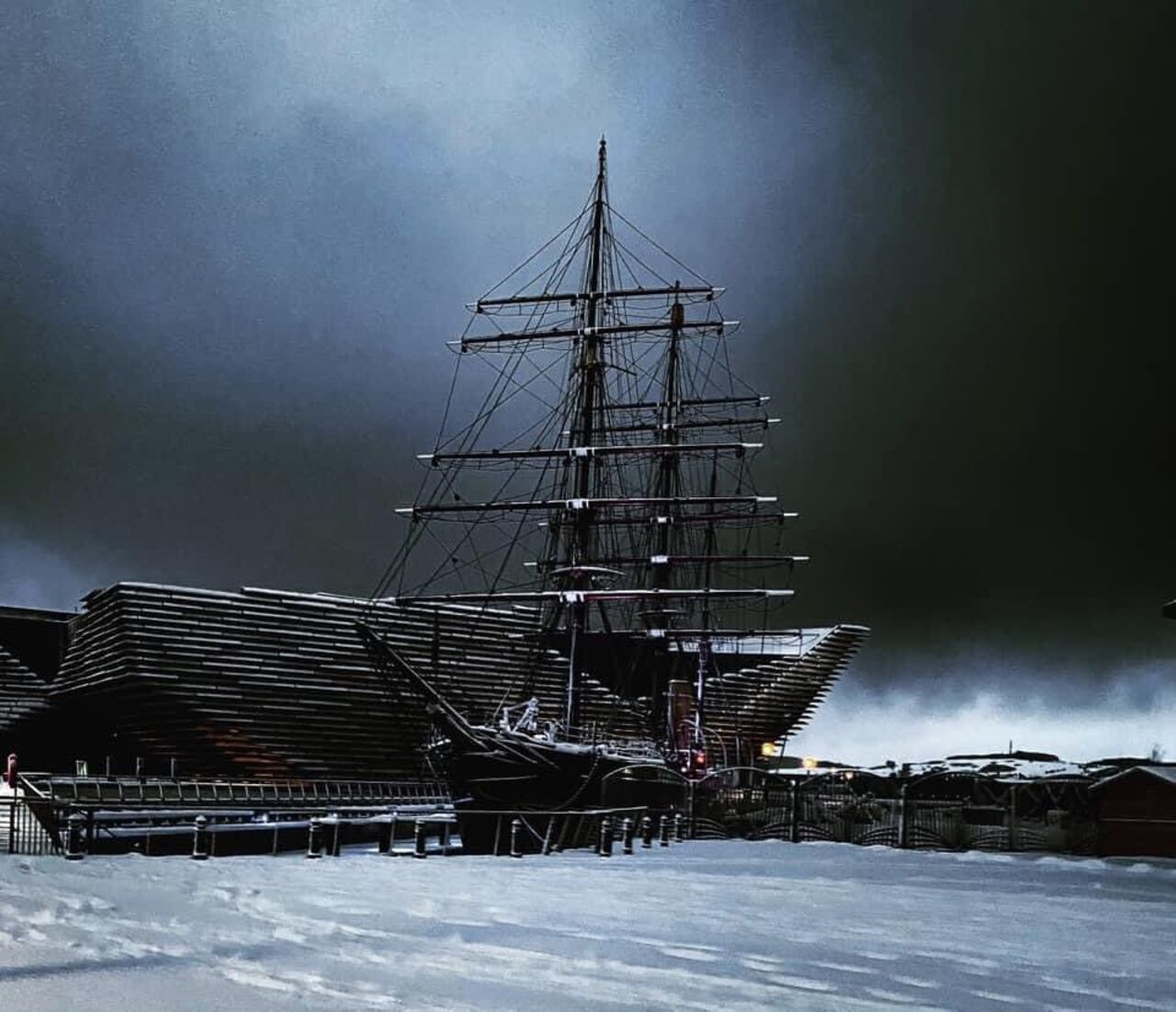 A snowy image of RRS Discovery and V&A Dundee