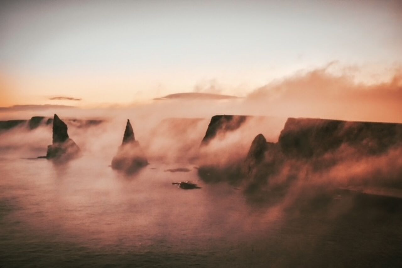 A striking image with mist hovering over Duncansby stacks.