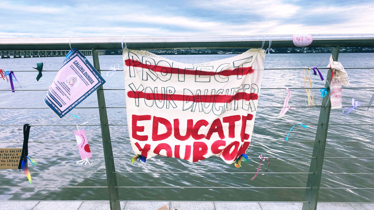 Banners next to the Tay protest against gender-based violence