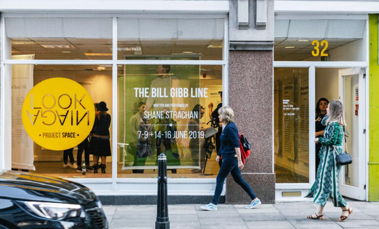 Shop window showing Shane Strachan's exhibition