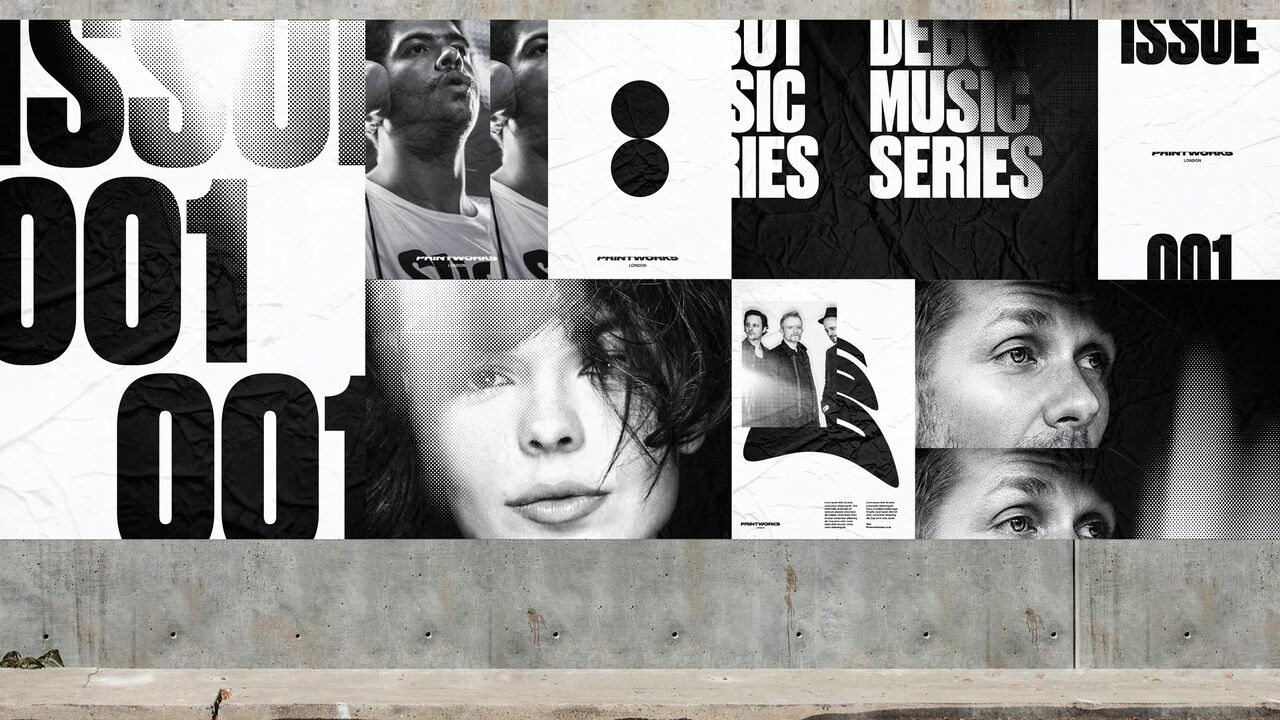 Black and white posters of faces and graphics on a concrete wall.