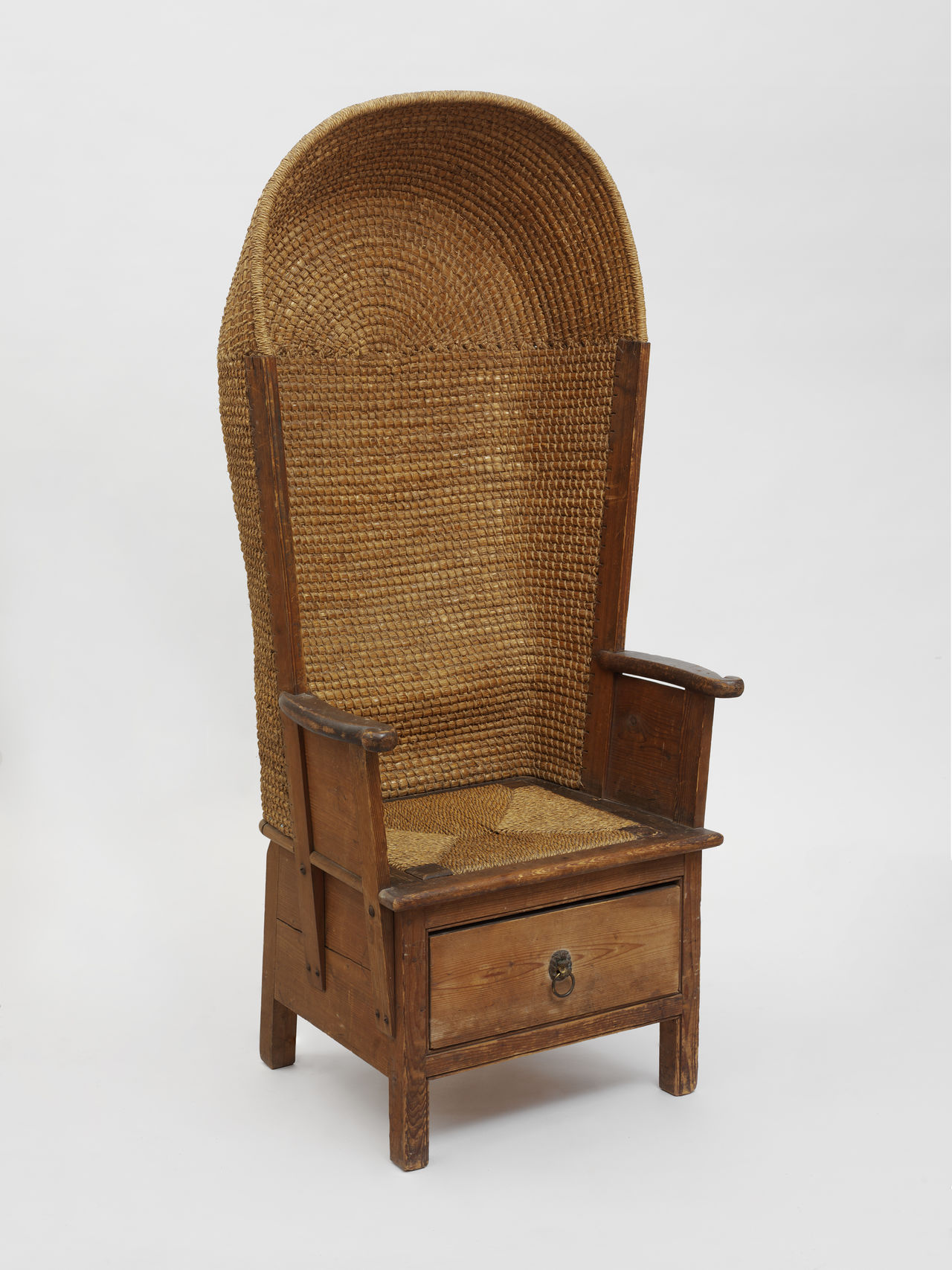A high-backed, woven Orkney Chair.