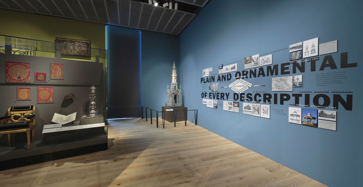 A photo of the galleries in V&A Dundee with the focus on a small-scale model of the Scott Monument in the corner.