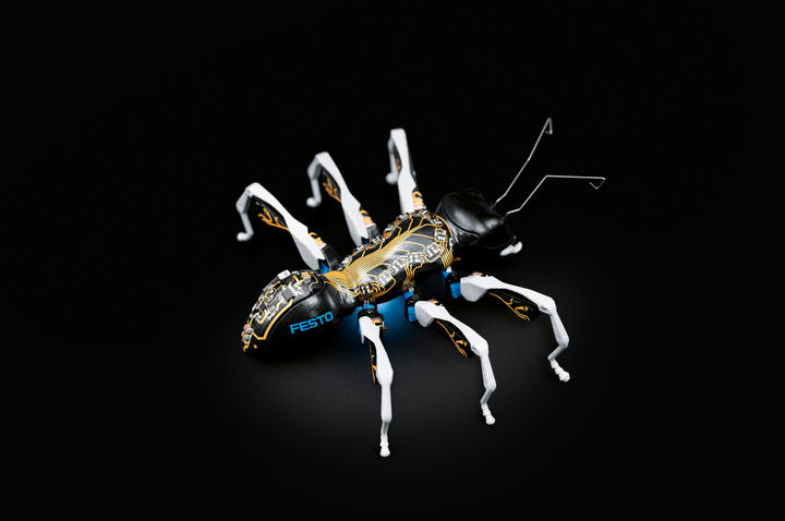 A robotic ant against a black background.