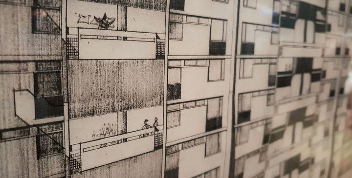 Close-up line drawings of a building with simple figures hanging out washing and sitting in the windows.