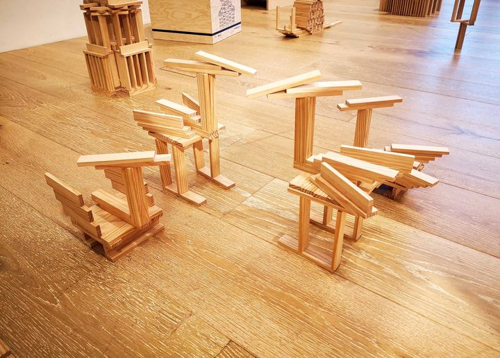 Several bird-like structures built using small planks of wood.