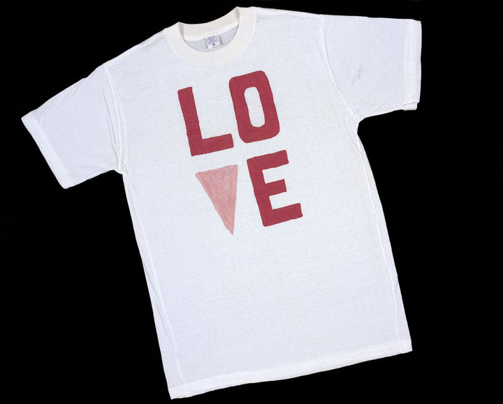 White cotton T-shirt from V&A's collection printed with 'LOVE with pink triangle'.