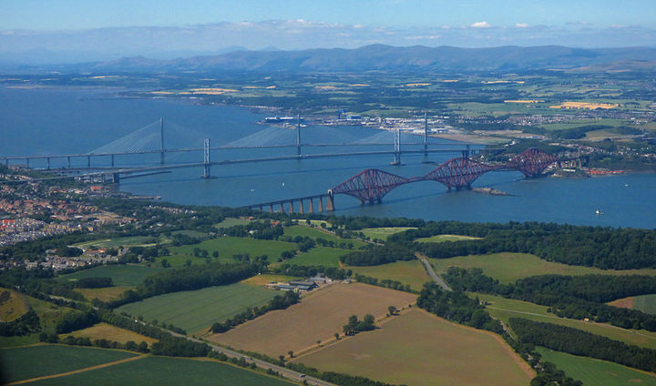 Image from above of the three Forth Bridges spanning the Firth of Forth. Photo by Thomas Nugent