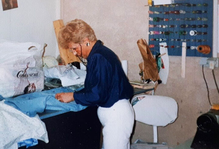 Archive picture of Faiza's great aunt sewing in her studio