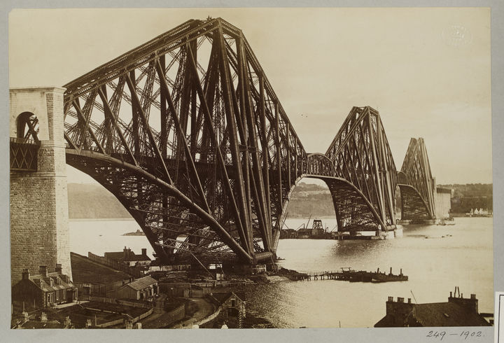 Sepia photograph of the Forth Bridge just after its construction.