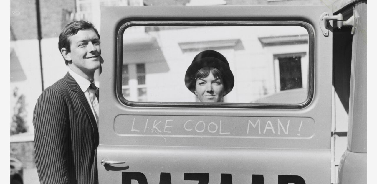 A black and white image of Mary Quant and her husband, Alexander Plunkett-Greene, standing at the door of a car with the text 'bazaar' on the side of it.