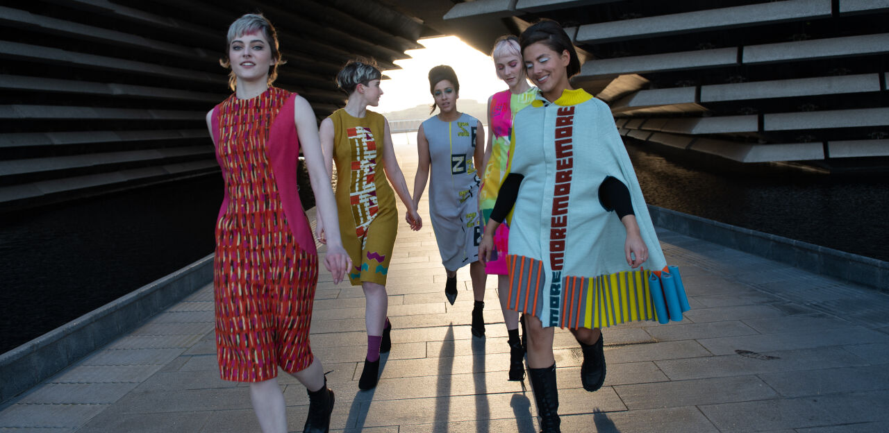 Five models in Quant-inspired garments running through the arch at V&A Dundee.