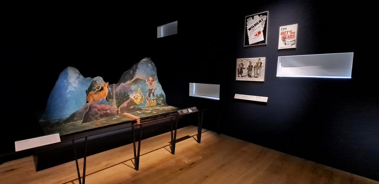 Photo of the galleries in V&A Dundee with a large pop-up book that acts as a stage set for a play.